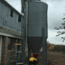 man fixing water tower